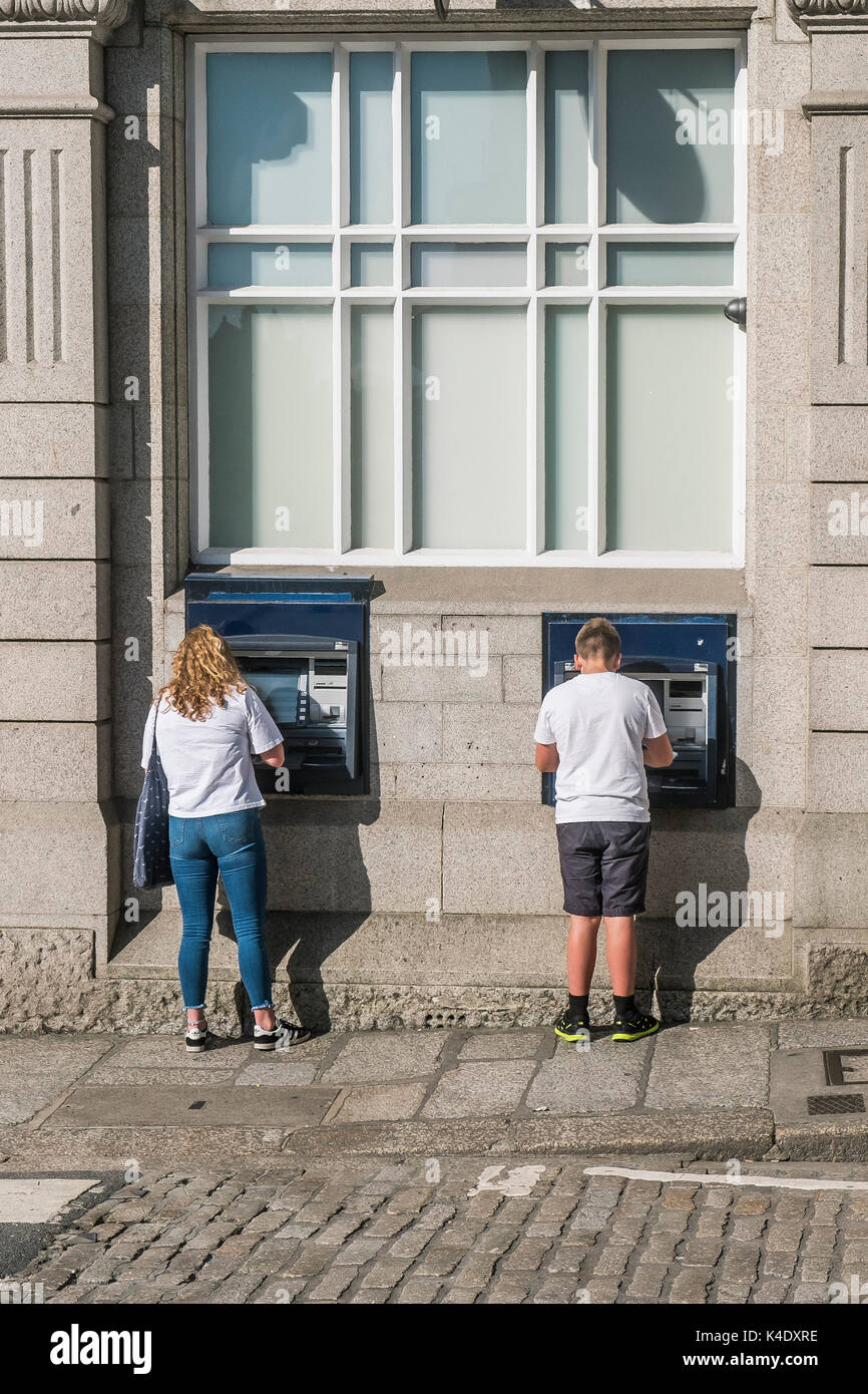 ATM - customers using ATM in a city centre. - Stock Image