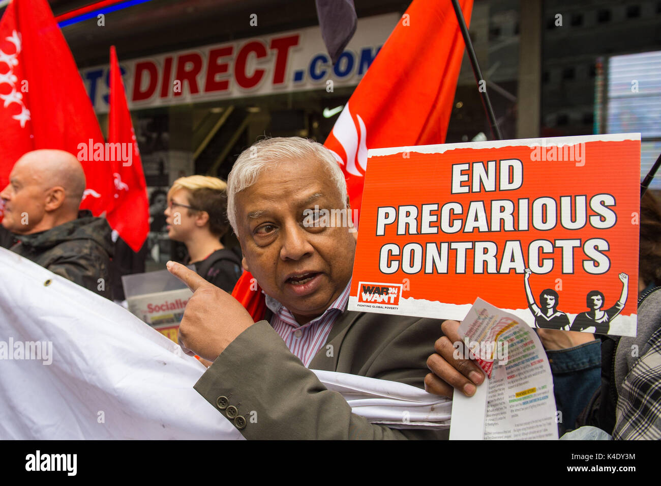 Protesters outside the Sports Direct flagship store on Oxford Street in London as the troubled retailer has been accused of reneging on a promise to offer guaranteed hours to staff on zero hour contracts in a fresh blow to the company ahead of its annual meeting. - Stock Image