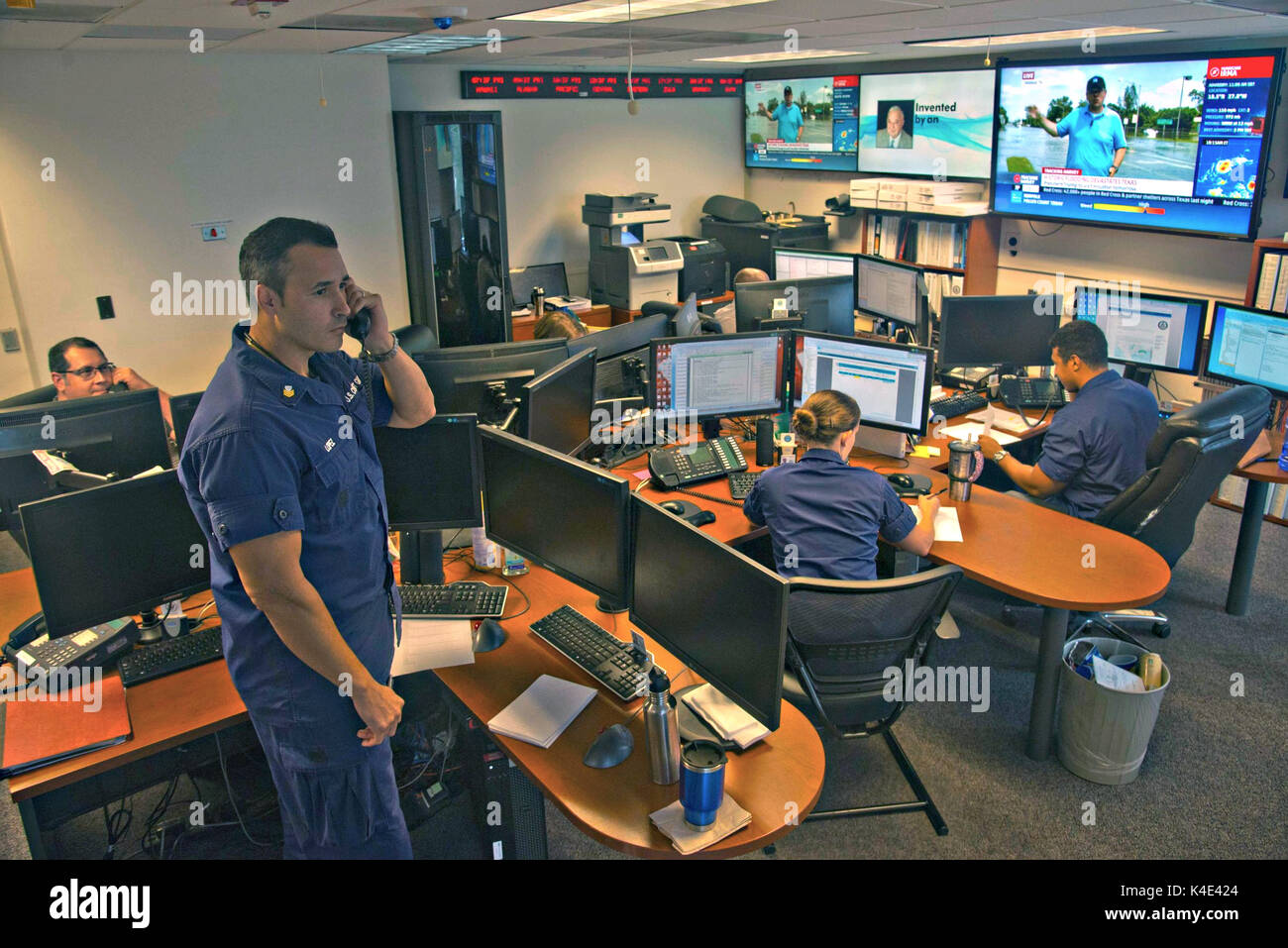 U.S. Coast Guard personnel monitor search and rescue for Hurricane Harvey victims from the Atlantic Area Command Center September 1, 2017 in Portsmouth, Virginia. The center had to step in to assist the high volume of emergency calls from the storm which overwhelmed local Texas regional operations. - Stock Image