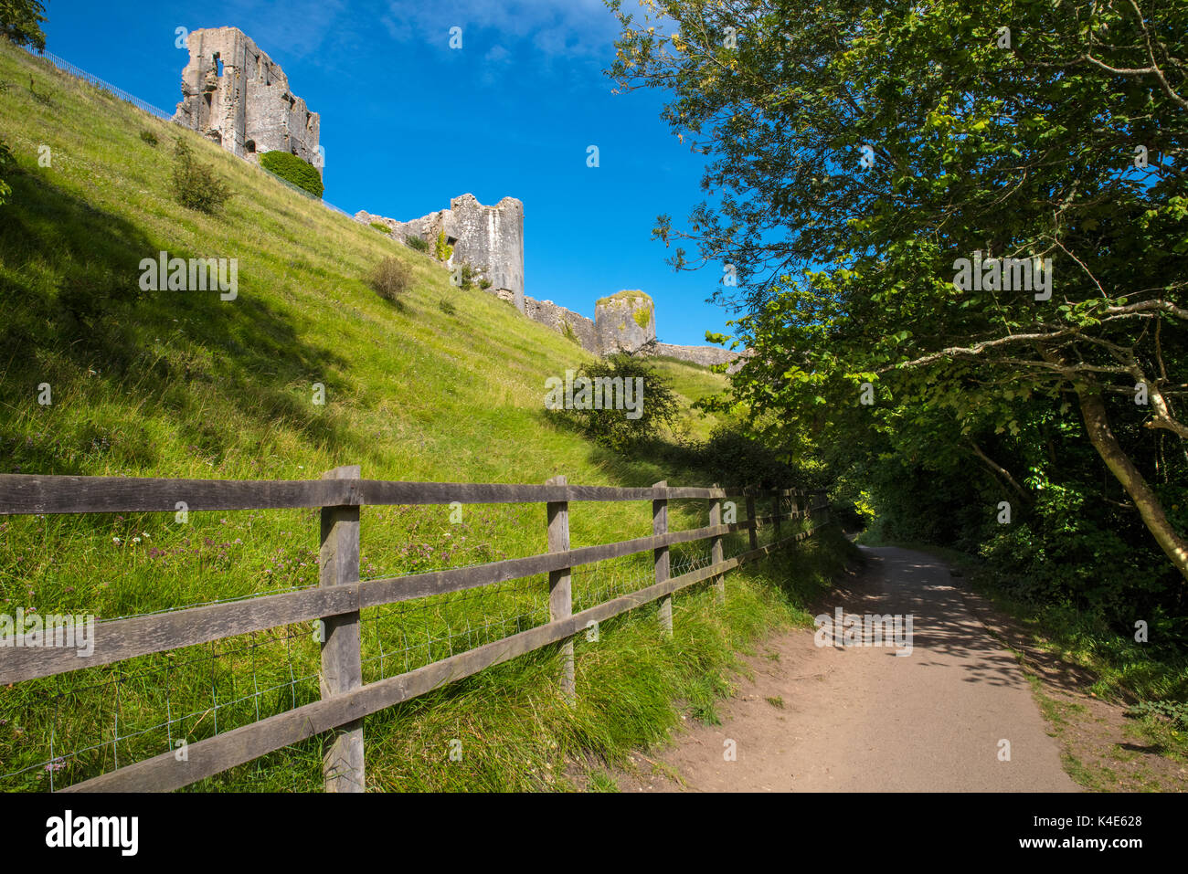 A woodland walk passing by the remains of Corfe Castle in the beautiful county of Dorset, UK. - Stock Image