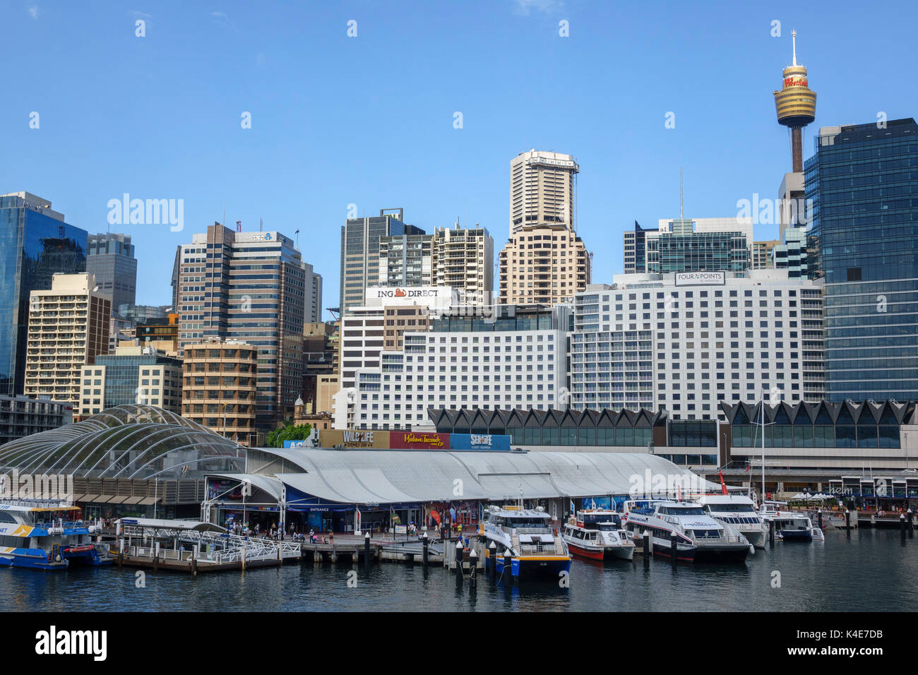 Sydney Central Business District Skyline From Darling Harbour Australia Includes The Sydney Aquarium And Madame Tussauds - Stock Image