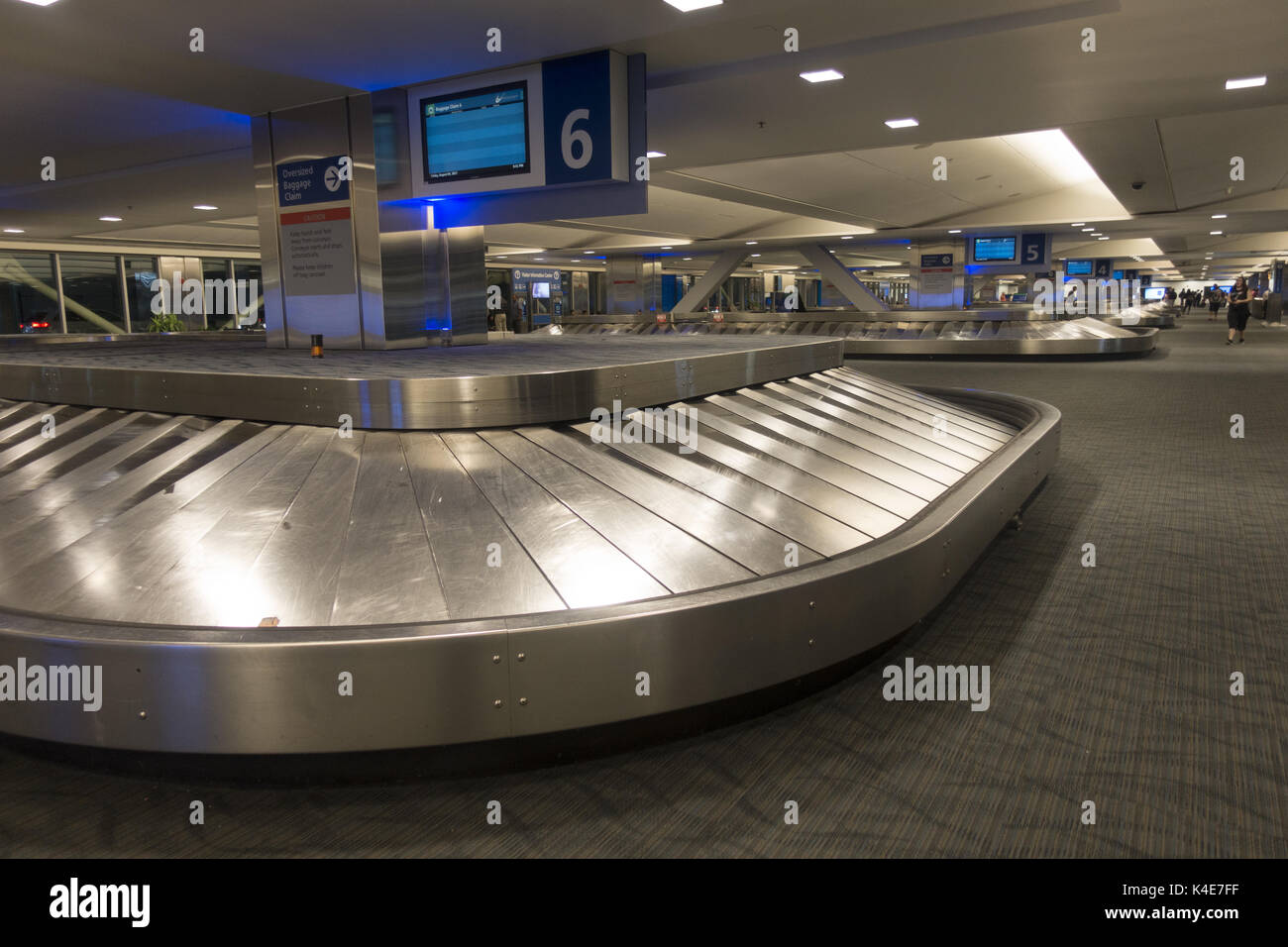 Empty Baggage Claim area at Detroit International Airport when flights are canceled due to weather conditions. - Stock Image
