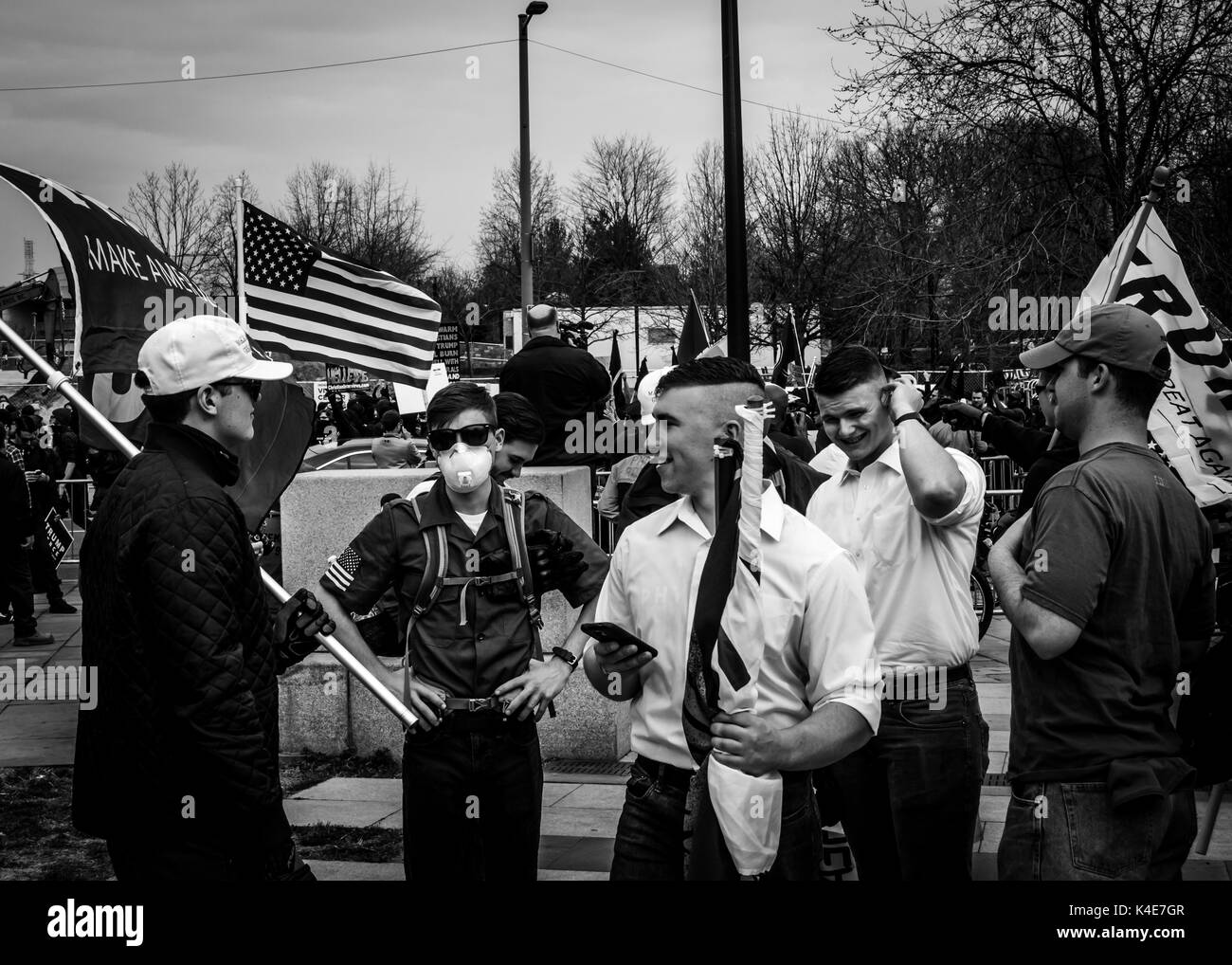Members of Vanguard America, a violent Fascist organization distinguished by their white polo shirts, arrive at the rally. - Stock Image