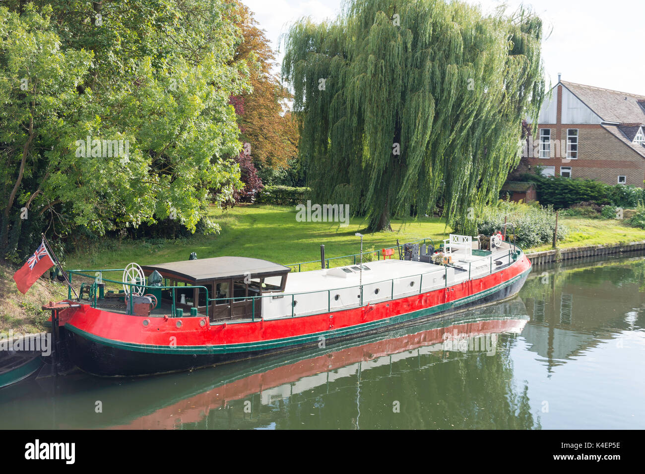 Old barge moored on River Thames riverbank, Pangbourne, Berkshire, England, United Kingdom - Stock Image