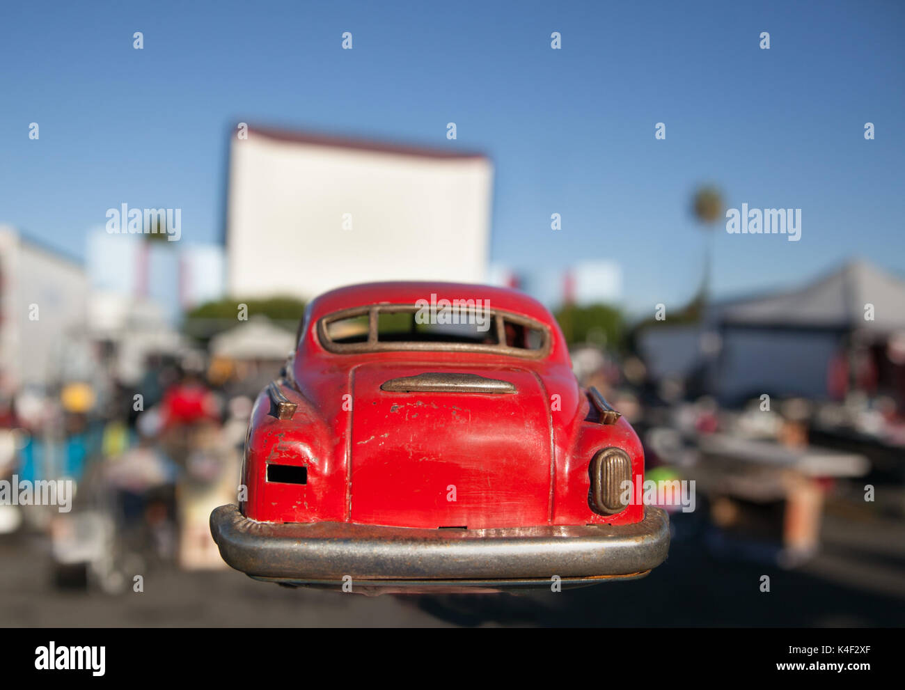 Rear end of old vintage classic metal toy car at swap meet  drive in. This car was found while treasure hunting at the Roadium open air flea market. - Stock Image