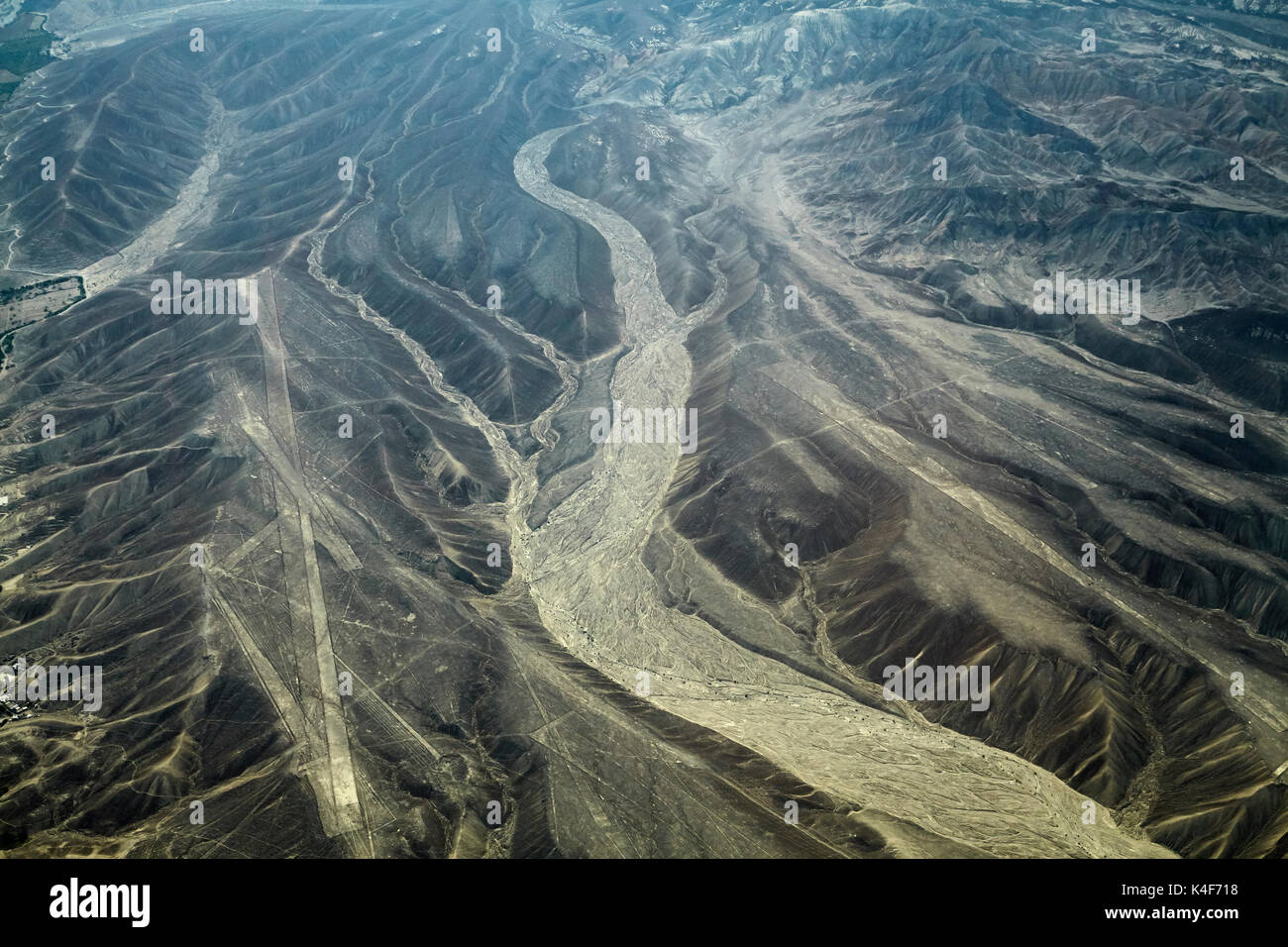 Palpa Lines (ancient geoglyphs) and dry riverbed in the desert near Nazca, Ica Region, Peru, South America - aerial - Stock Image