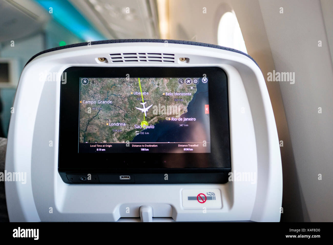 Boeing 787 headrest screen showing destination information, route map, airplane arriving in Sao Paulo, Brazil - Stock Image