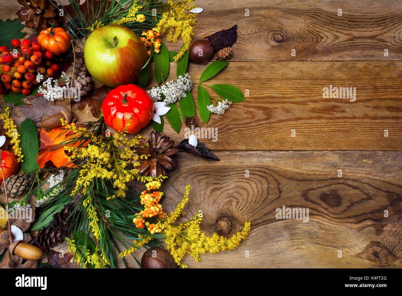 Happy Thanksgiving Decor With Pumpkin Apples And Rowan Berries On The Left Side Of Rustic Wooden Table Fall Background Seasonal Vegetables