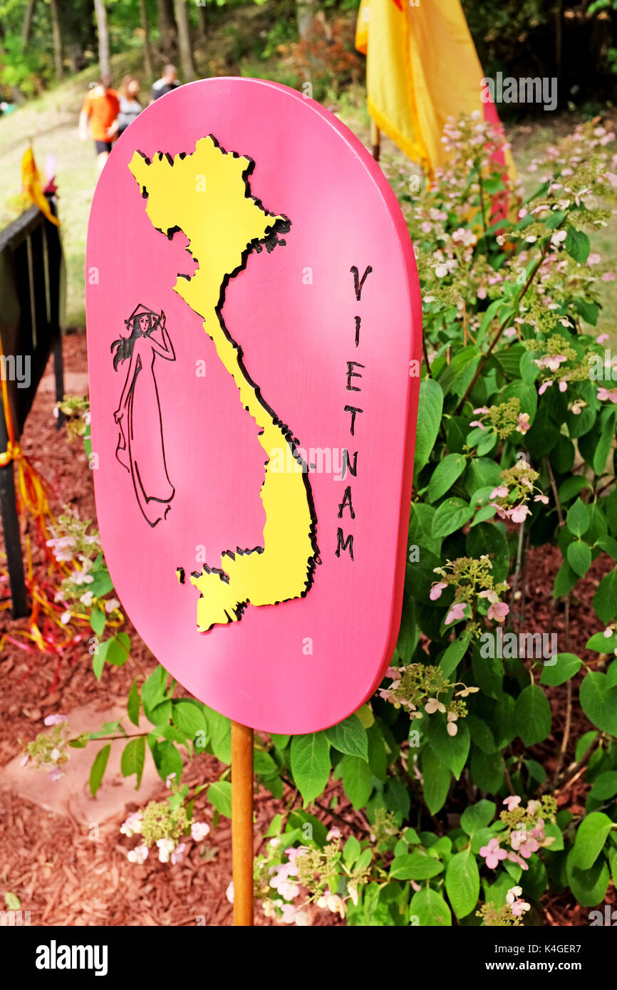 A wooden signmarker with a map of Vietnam and a woman in traditional dress at the Vietnam Cultural Garden in Rockefeller Park in Cleveland, Ohio, USA. - Stock Image
