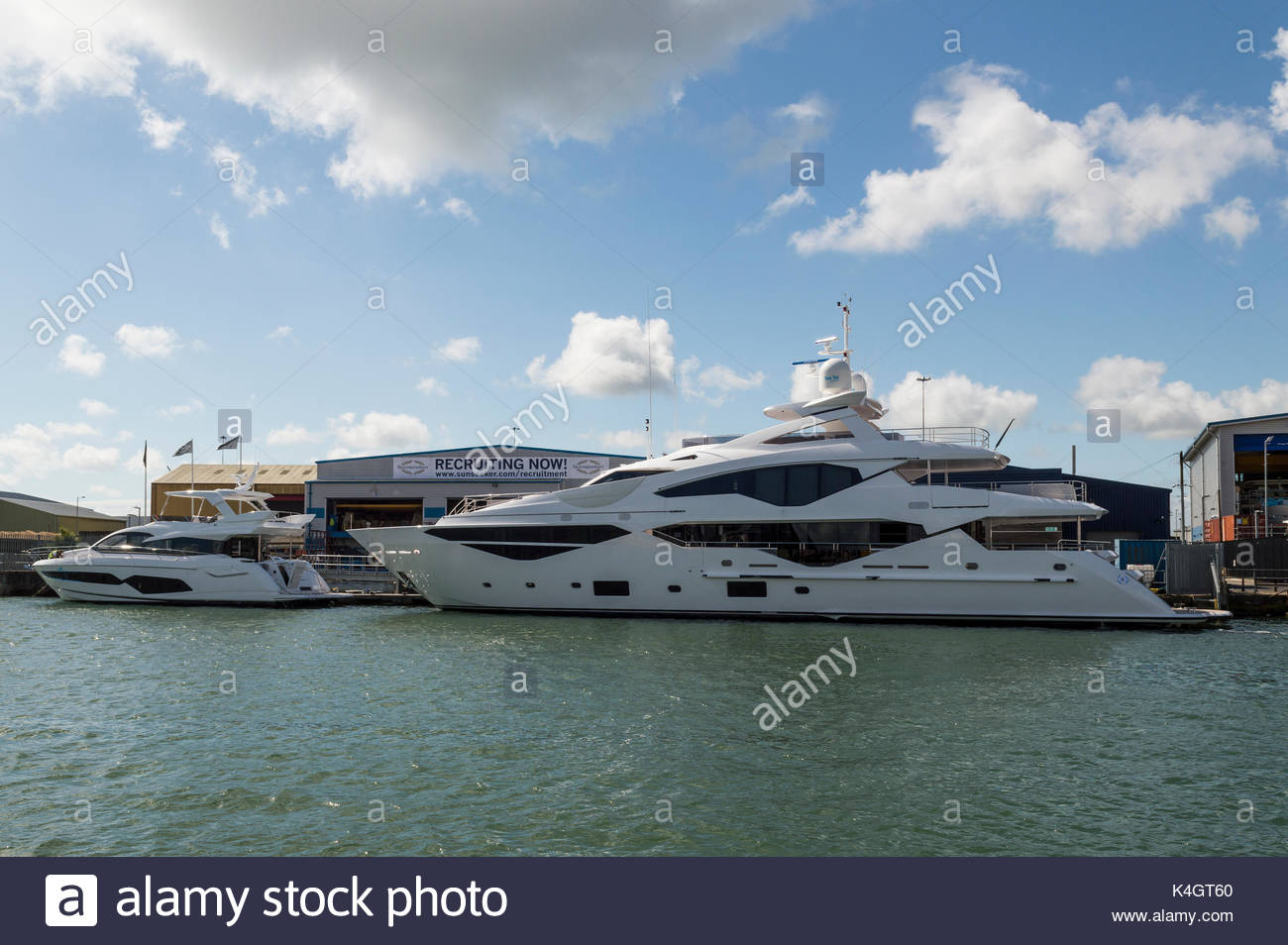 Sunseeker factory with Recruiting Now! sign, Poole, Dorset, England, UK Stock Photo