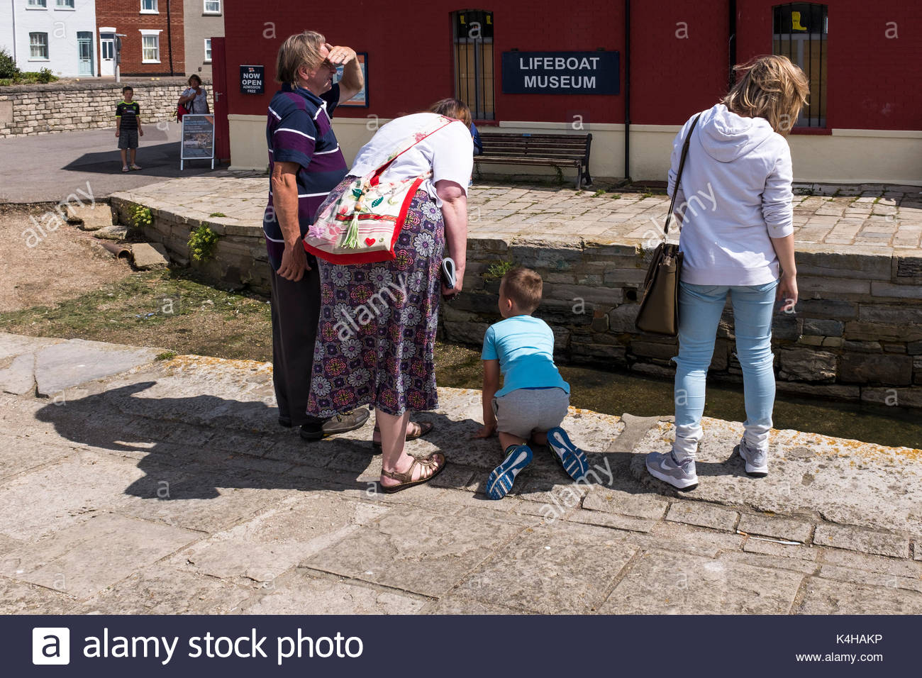 People by Poole Quay and slipway on a warm summer day, Poole, Dorset, England, UK Stock Photo