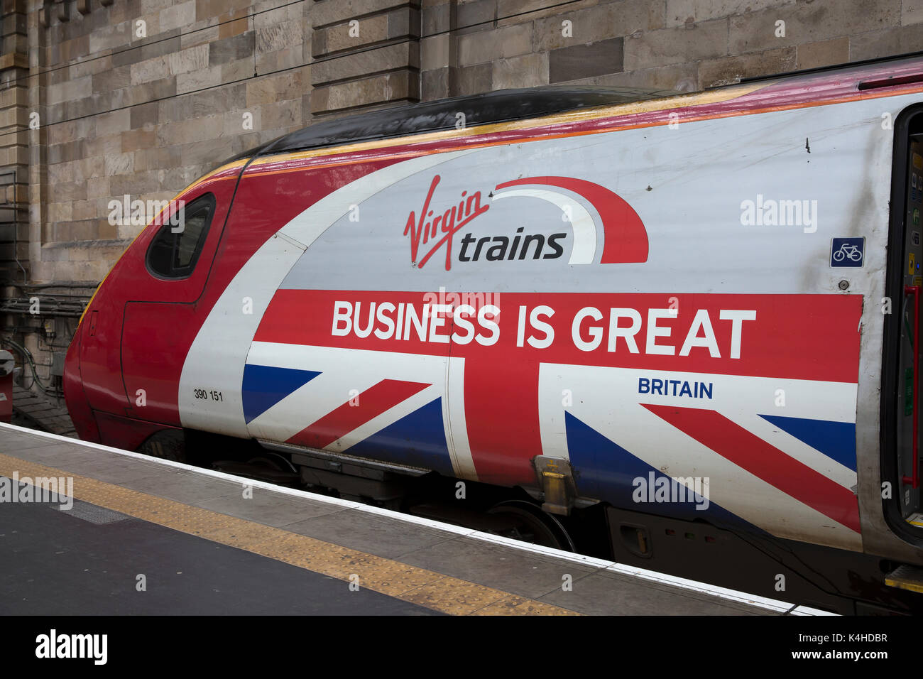 Virgin Pendolino train in Glasgow Central station with an advert Virgin trains, Business is Great Britain - Stock Image
