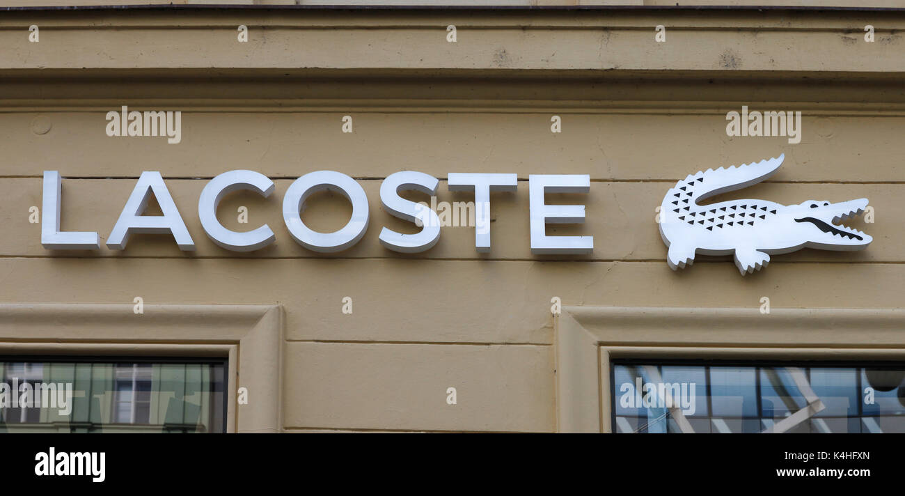 wholesale dealer 6a73c cacf3 Lacoste sign on a store. Lacoste is a French clothing ...