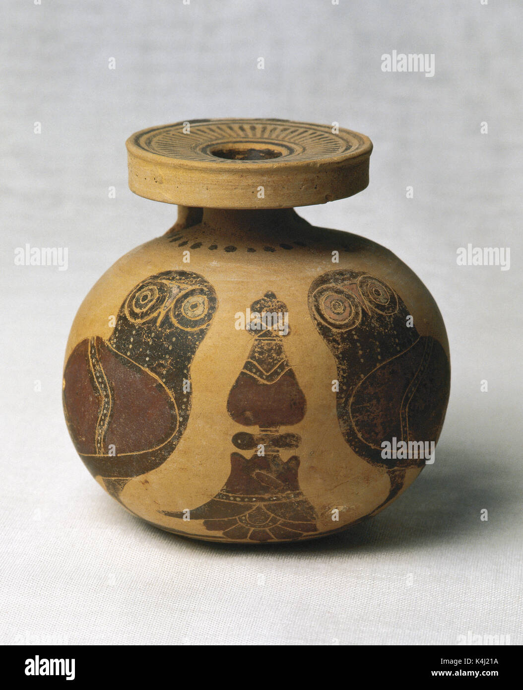Greek Art. Aryballos with owl decoration in black and red, separated with floral motifs. 6th century BC. From Corinth (Greece). Perfume Museum. Barcelona. Spain. - Stock Image