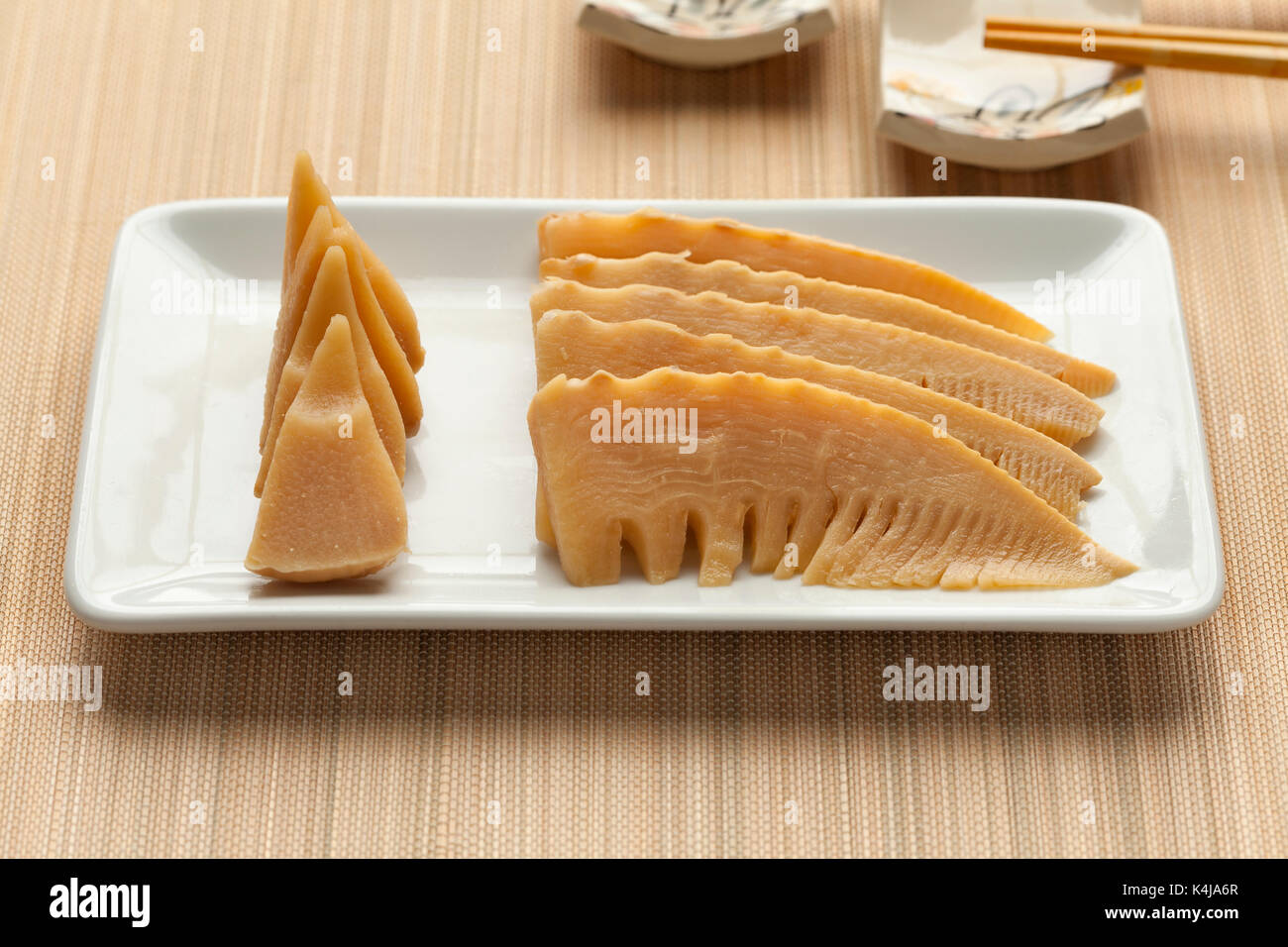 Japanese simmered young bamboo shoots on a dish - Stock Image