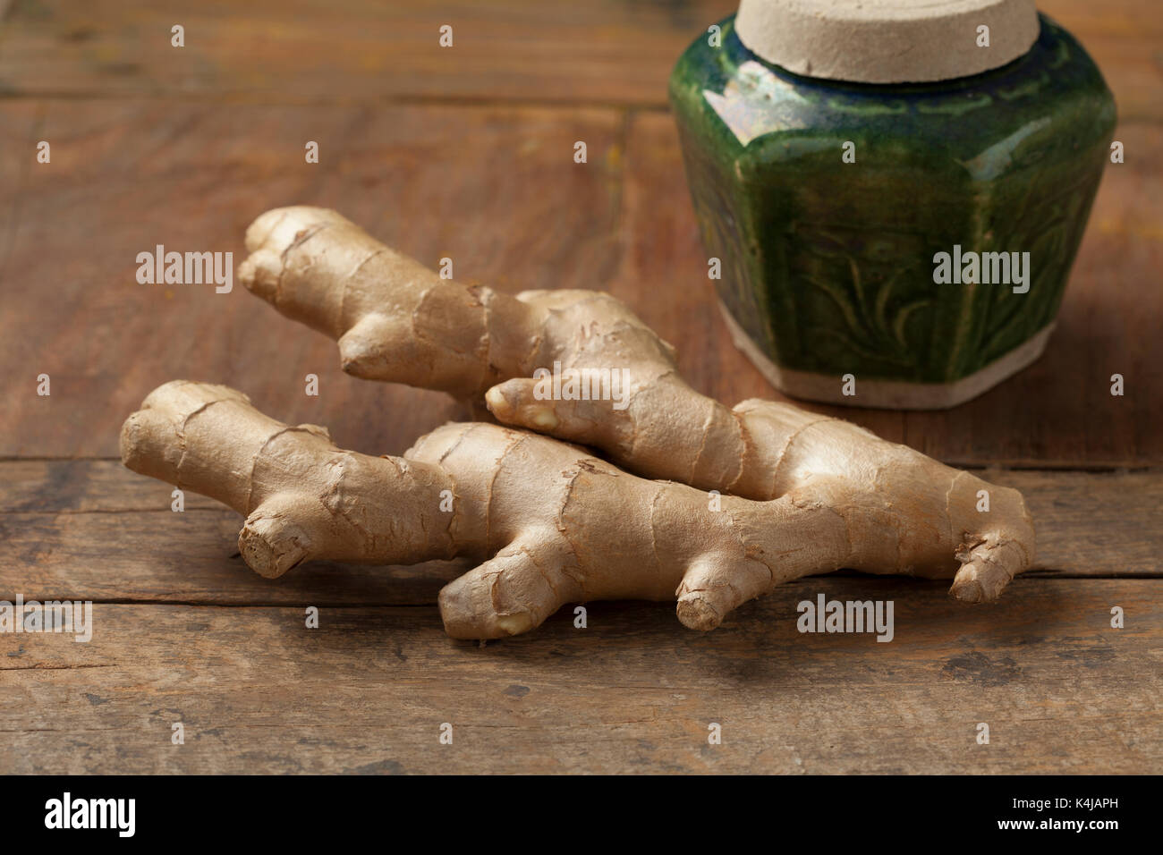 Fresh ginger root and a heirloom chinese ginger pot - Stock Image