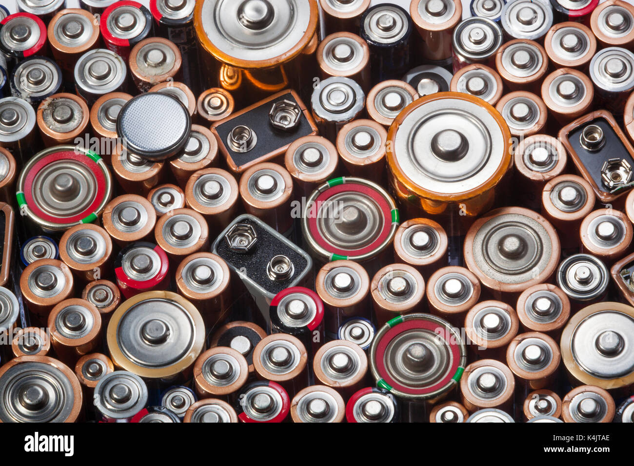 Old used batteries ready for recycling - Stock Image