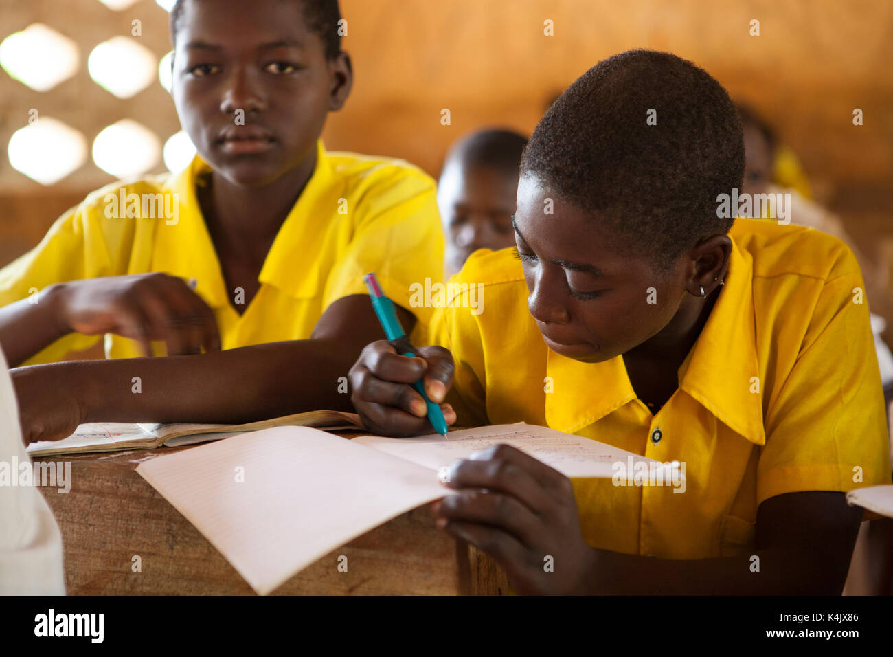 Students studying in classroom at a Junior High School, Northern Ghana, West Africa, Africa - Stock Image