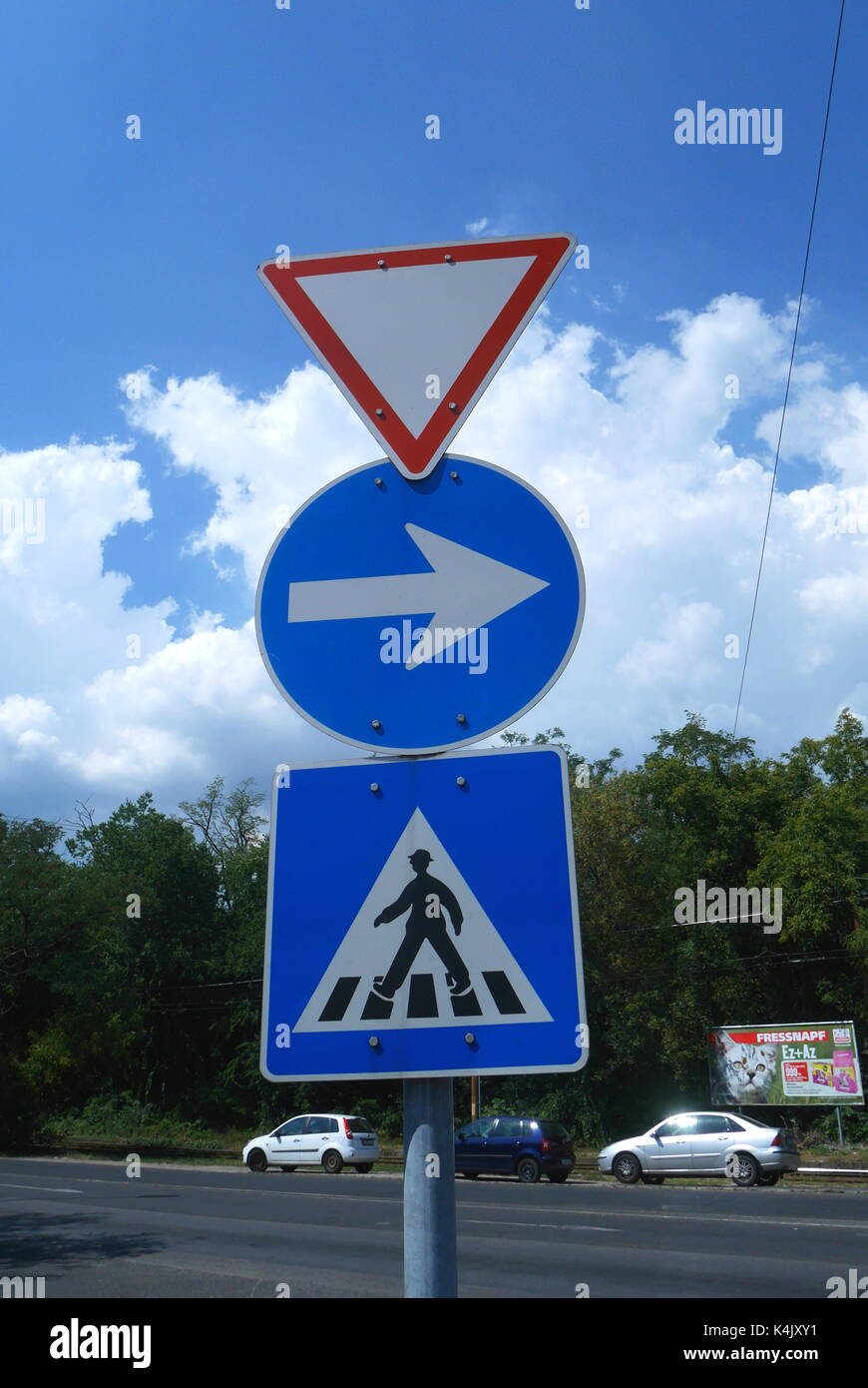 Road signs indicating give way, one way, pedestrian crossing, Budapest, Hungary - Stock Image