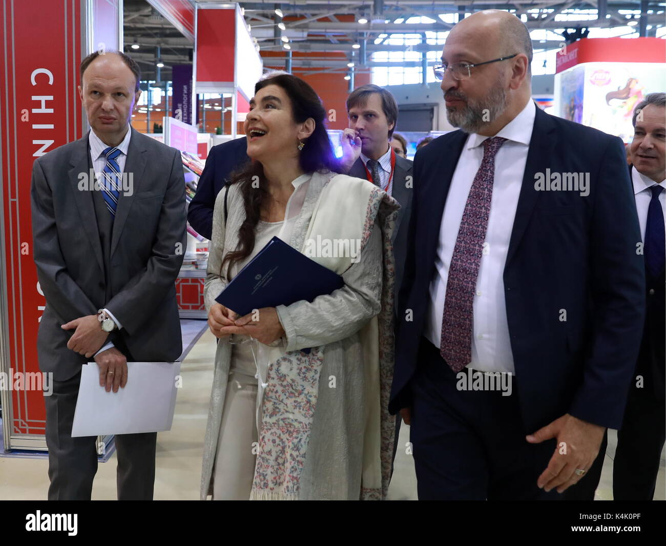 Moscow, Russia. 6th Sep, 2017. Mikhail Seslavinsky, Head of the Russian Federal Agency for Press and Mass Communication, Greece's Culture and Sport Minister Lydia Koniordou, and Konstantin Antipov (L-R), Integration Vice Rector of the Moscow Polytechnic University and Director of the Moscow Polytech Higher School for Printing and Media Industry, visit the 30th Moscow International Book Fair at Moscow's VDNKh Exhibition Centre. Credit: Sergei Fadeichev/TASS/Alamy Live News - Stock Image