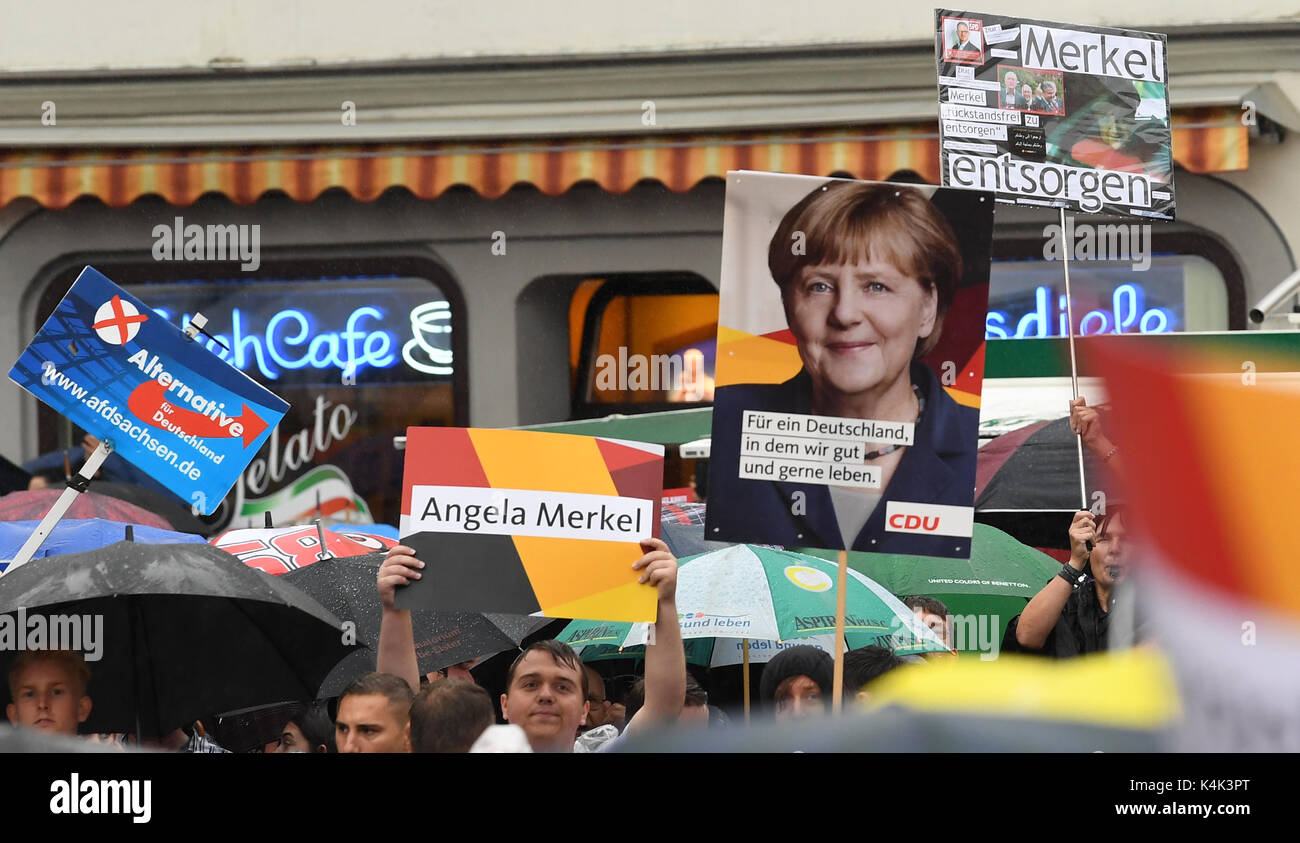 Supporters of different political parties voice their opinion during an CDUelection campaign in Torgau, Germany, Stock Photo