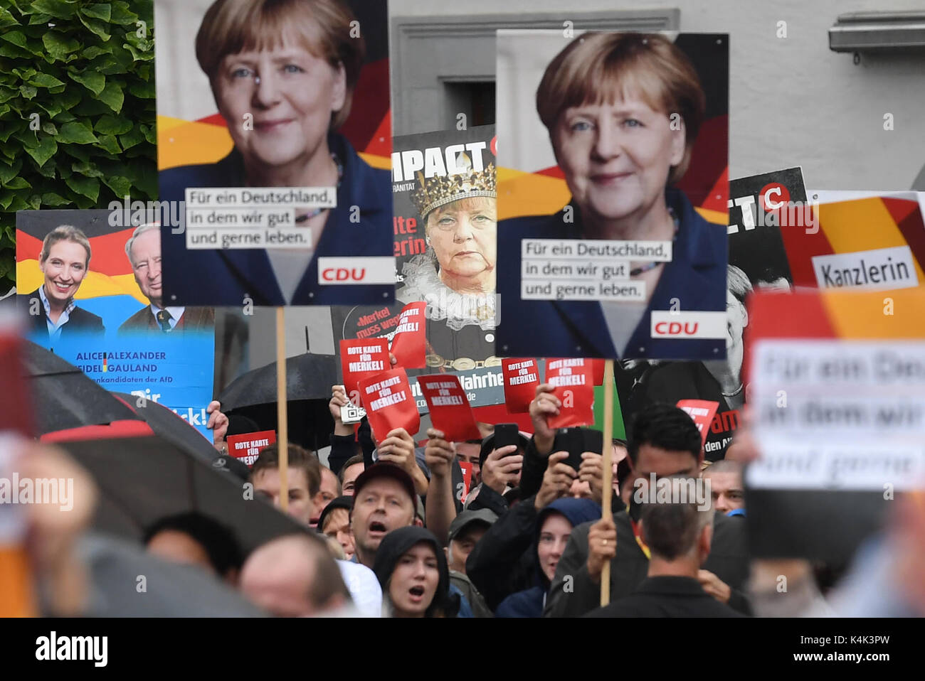 Supporters of different political parties voice their opinion during an CDU election campaign in Torgau, Germany, Stock Photo