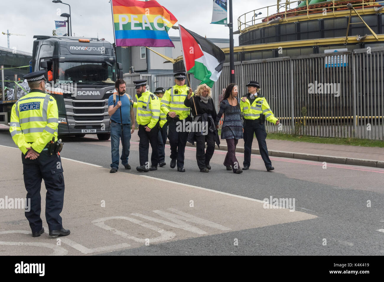 September 5, 2017 - London, UK - London, UK. 5th September 2017. Police officers lead protesters walking slowly Stock Photo