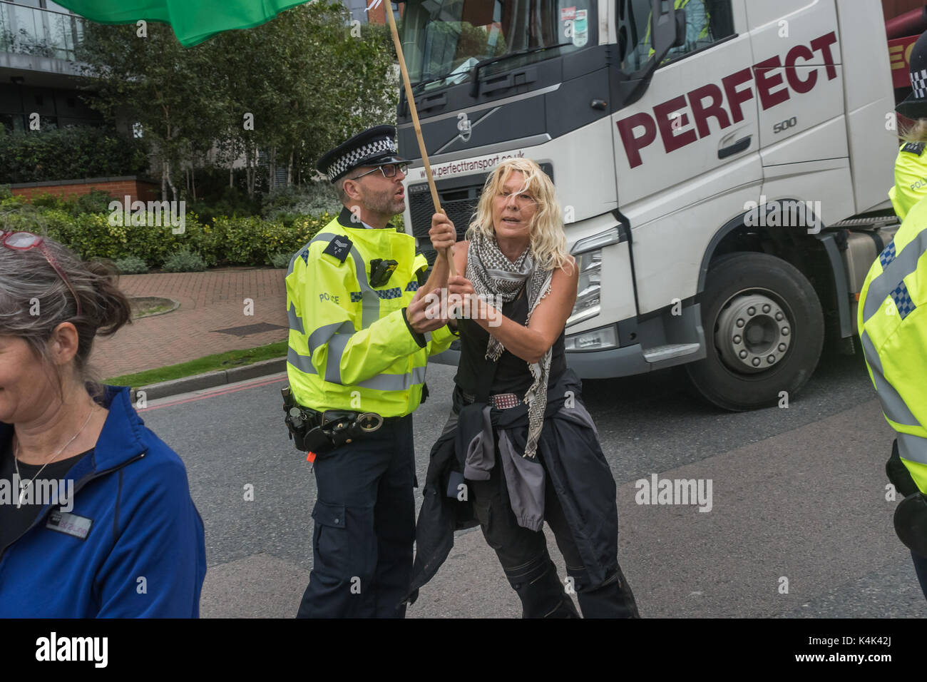 September 5, 2017 - London, UK - London, UK. 5th September 2017. A Police officer pushes a woman walking slowly Stock Photo