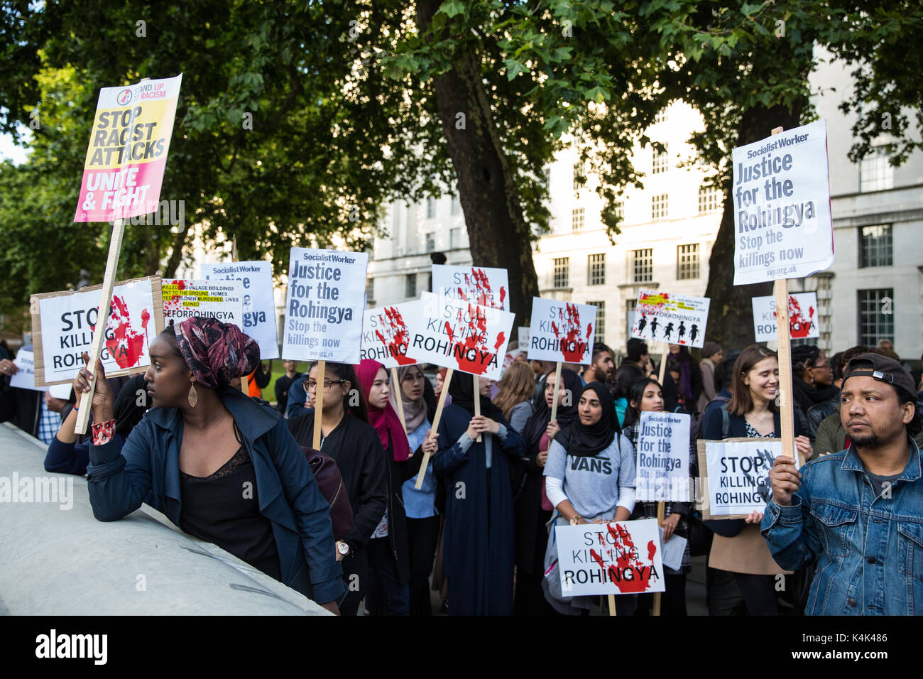 London, UK. 6th Sep, 2017. Protesters gather for an emergency rally opposite Downing Street intended to apply pressure on the British Government to intervene to prevent the killing of Rohingya people in Myanmar by the army and to urge Bangladesh and India to assist Rohingya refugees from Myanmar. Credit: Mark Kerrison/Alamy Live News - Stock Image