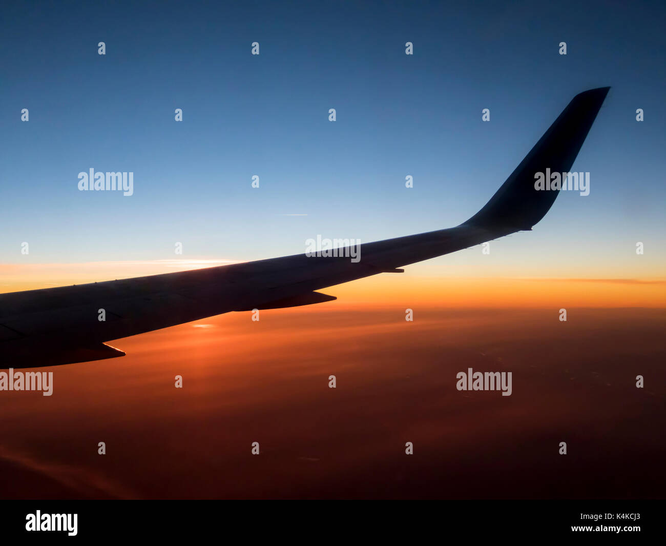 Airplane wing in sunrise, Germany - Stock Image