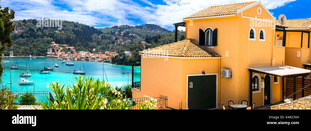 beautiful tranquil islands of Greece - Paxos (ionian islands). picturesque Lakka village and turquoise bay. Hollidays villas. - Stock Image