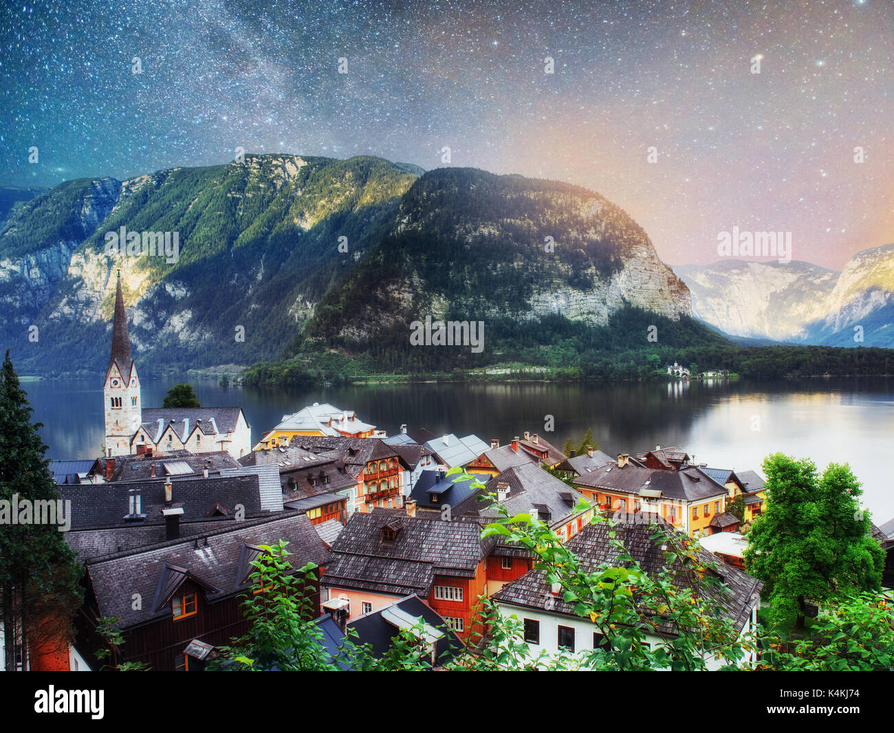 Scenic panoramic view of the famous mountain village in the Austrian Alps. Fantastic milky way. Hallstatt. Austria - Stock Image