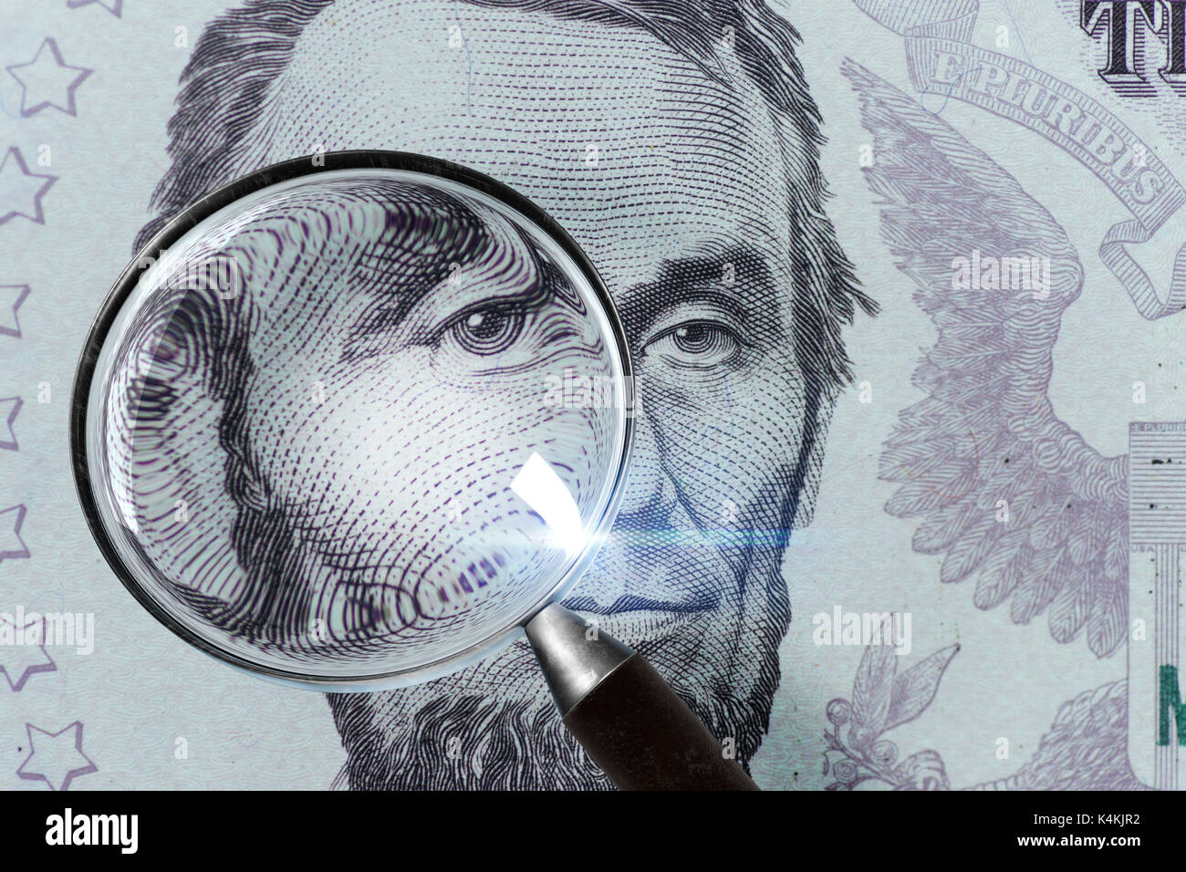 5 USD, US money close up under magnifying glass - Stock Image