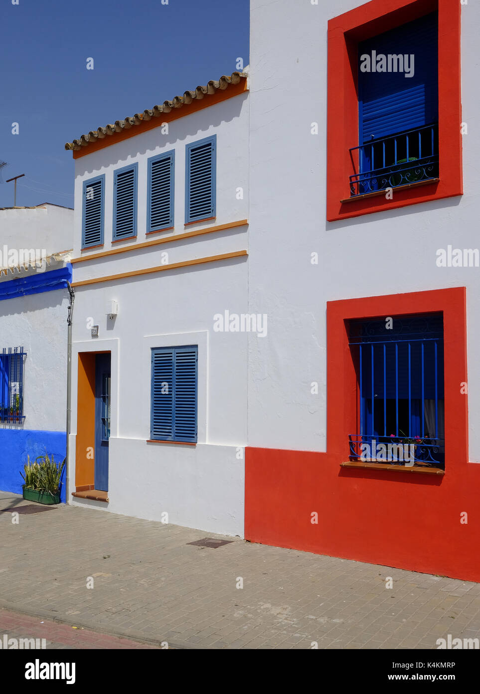 brightly painted houses in Isla del Moral, Spain - Stock Image