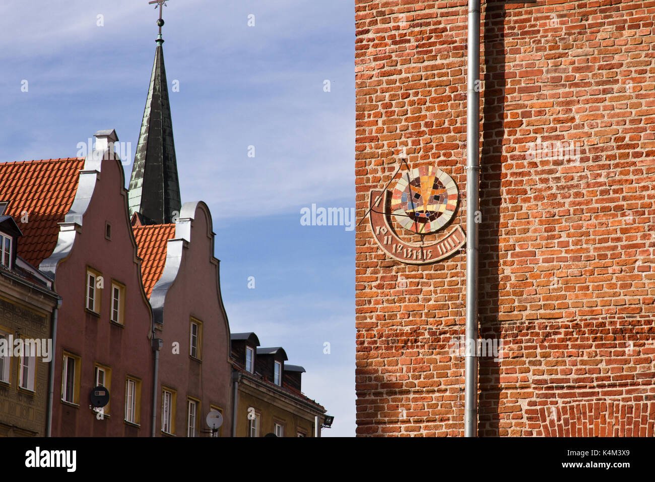 Sundial on the brick wall of Old Town Hall in Olsztyn. Poland. - Stock Image