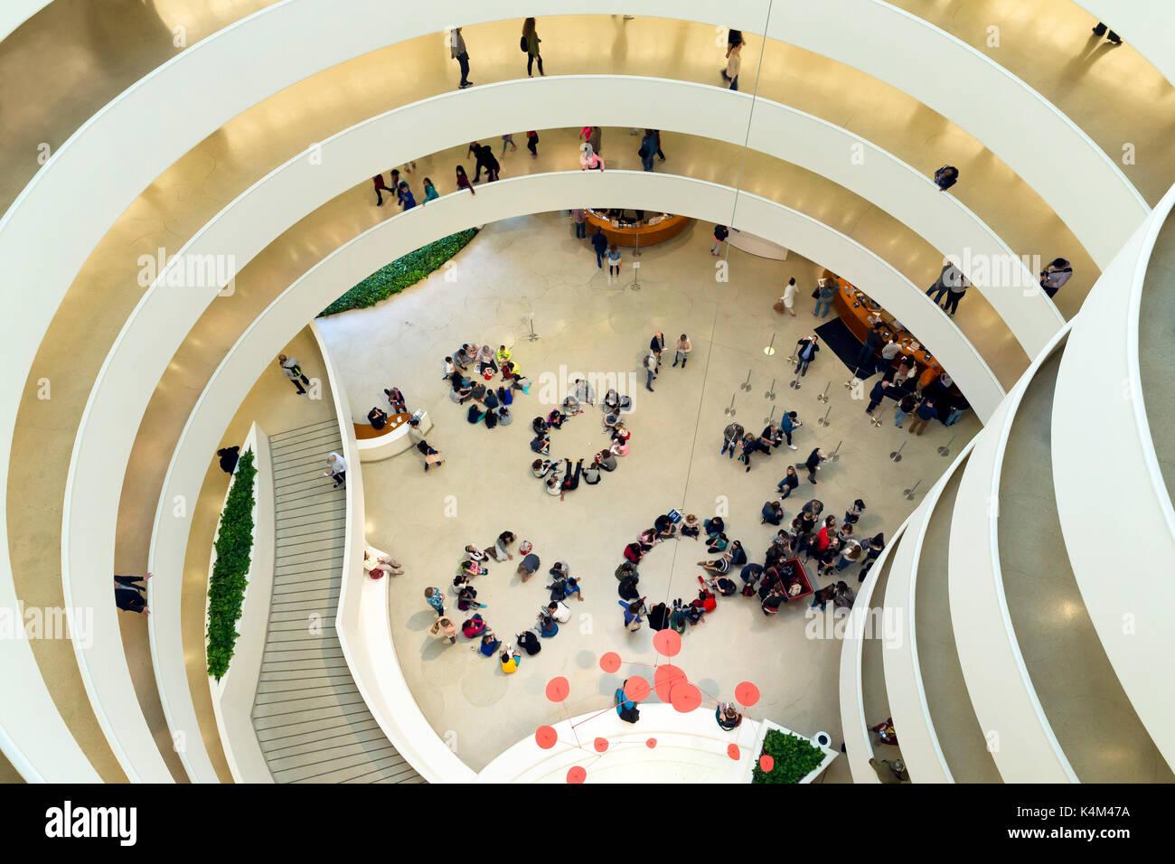 Interior of Solomon R Guggenheim Museum with schoolchildren, Manhattan, New York, USA Stock Photo