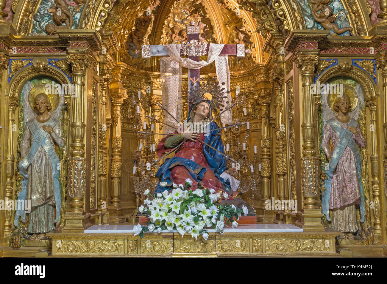 SALAMANCA, SPAIN, APRIL - 17, 2016: The carved polychrome baroque altar of Our Lady of Sorrow (Capilla de los Dolores) - Stock Image