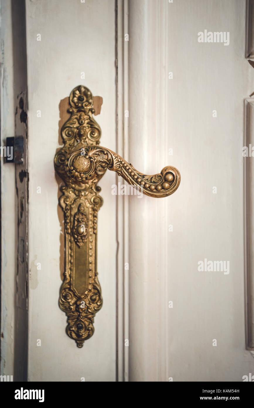 Antique interior brass door knob. Interior home architectural details. - Stock Image