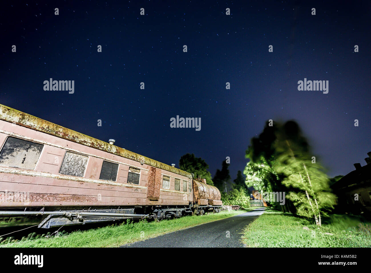 Rusty old train car with some stars in the skyw - Stock Image