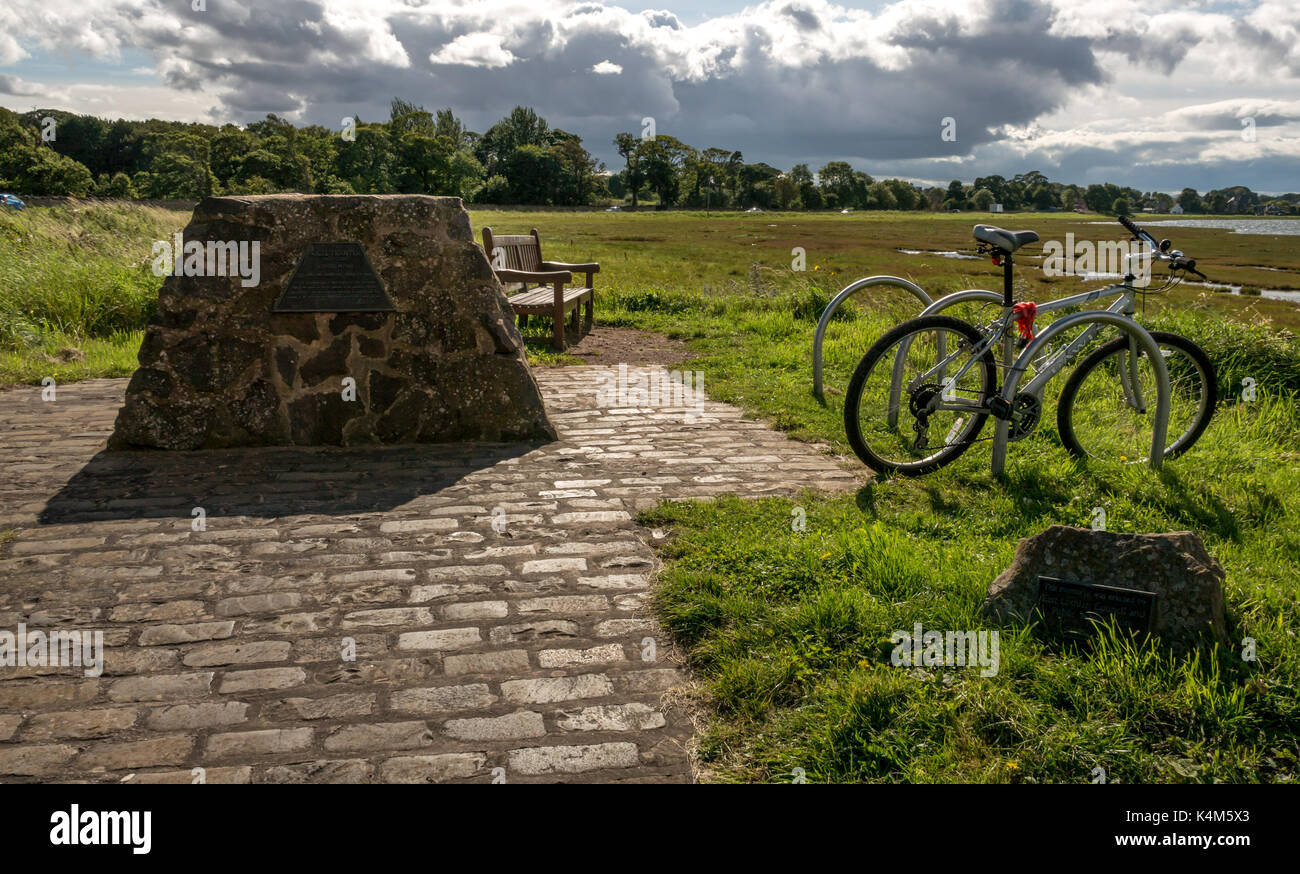 A bike stand next to a memorial to Nigel Tranter, author, at his favourite place, Aberlady Bay local nature reserve East Lothian Scotland, UK - Stock Image