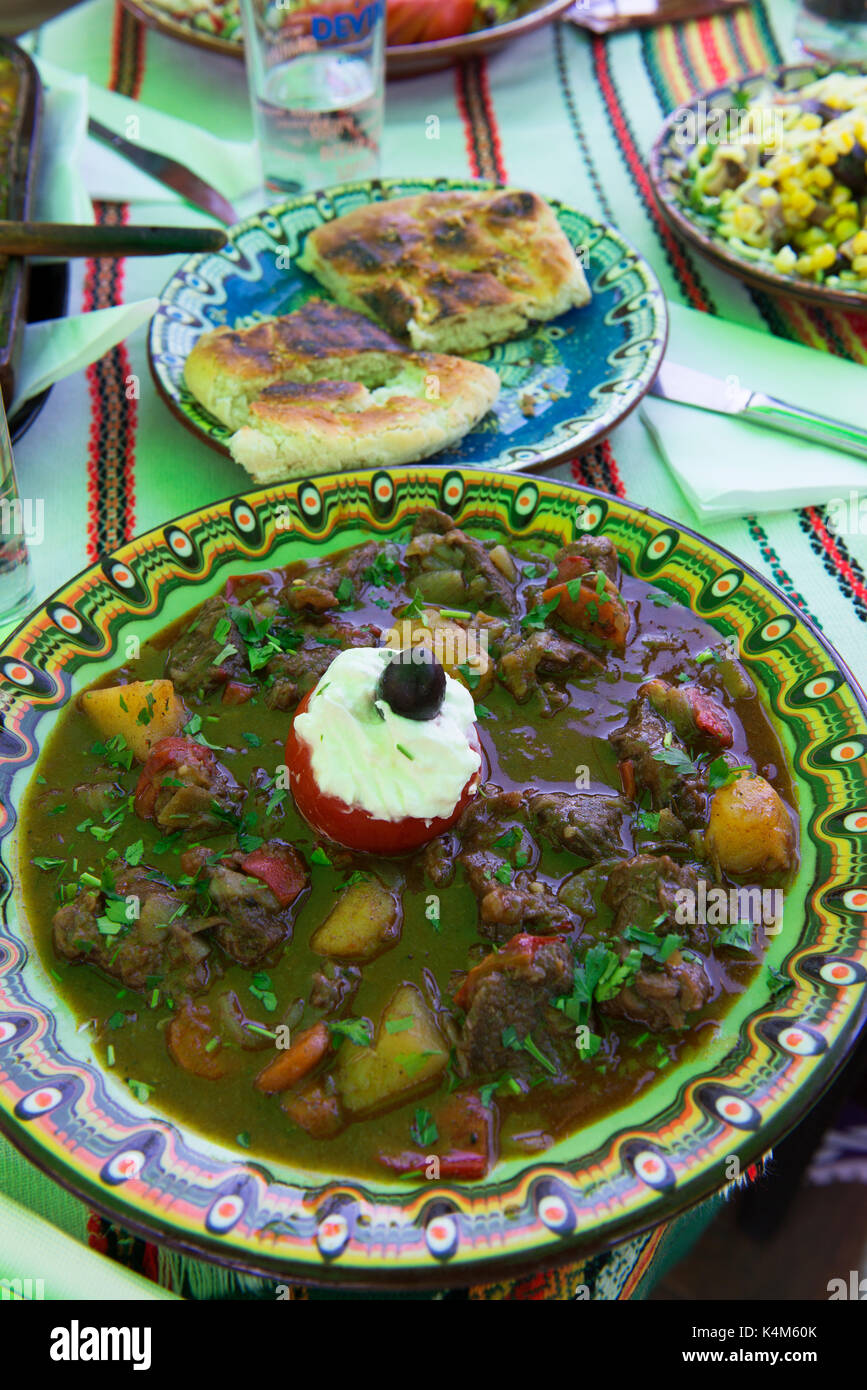 Traditional Bulgarian meal comprising a stew, bread and salad. - Stock Image