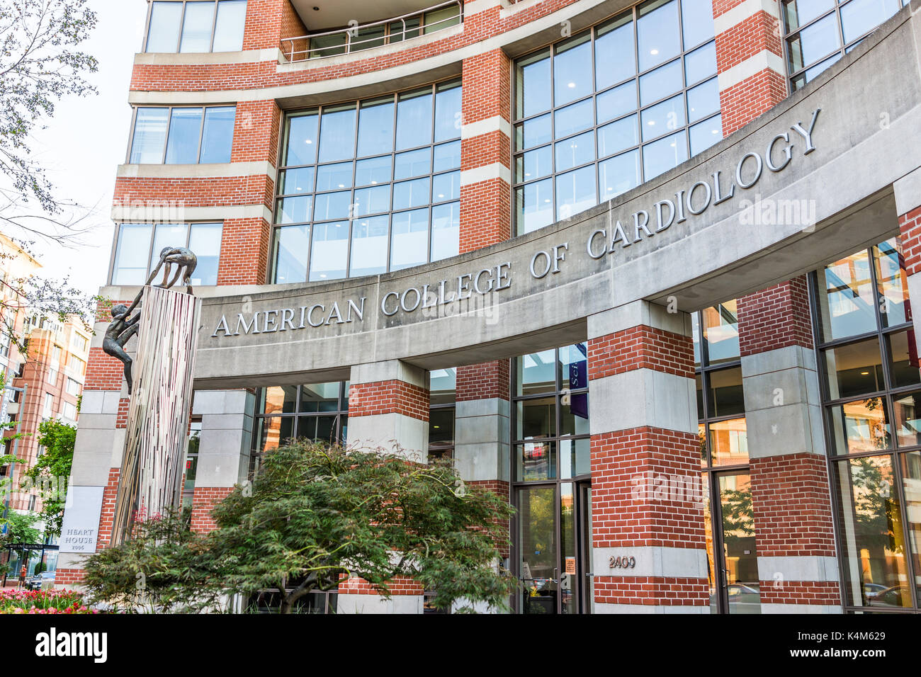 Washington DC, USA - August 4, 2017: American College of Cardiology sign on brick building with entrance - Stock Image