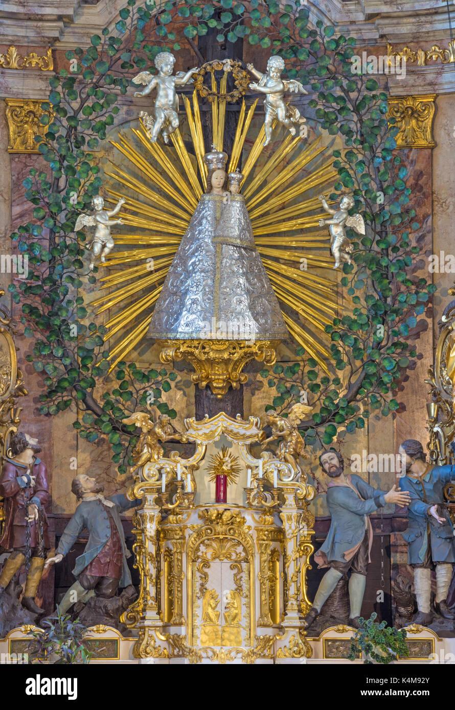 VIENNA, AUSTRIA - JULY 30, 2014: The central part main altar with statue of Madonna in church Pfarkirche Maria Hietzing by Matthias Steinl (1751). - Stock Image