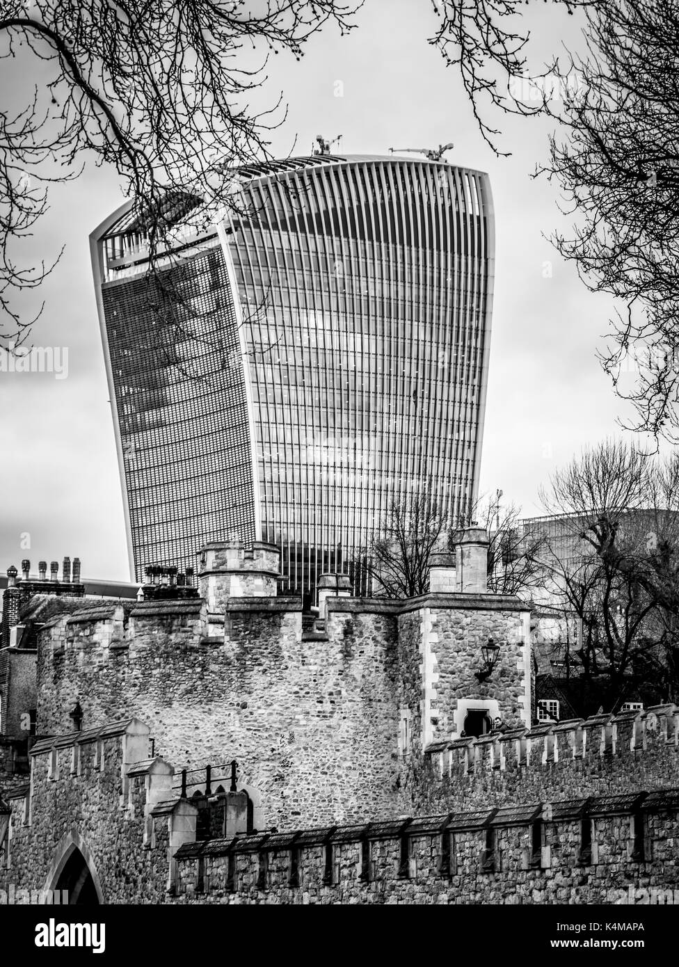 London , March 2017 United Kingdom: View of 20 Fenchurch St. building called walkie talkie and Tower of London Walls - historic castle on north bank o - Stock Image
