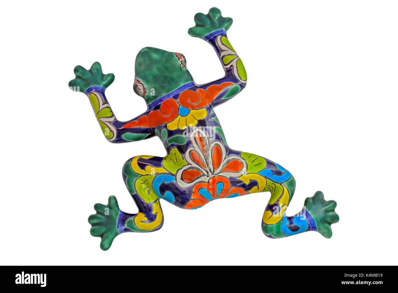 Colourful ceramic frog made in Mexico - white background - Stock Image