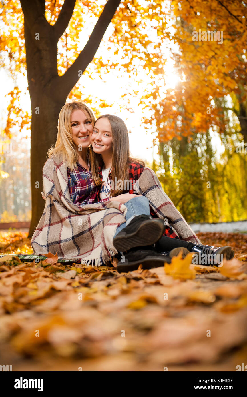 Gorgeous mother hugging her cheerful daughter Stock Photo