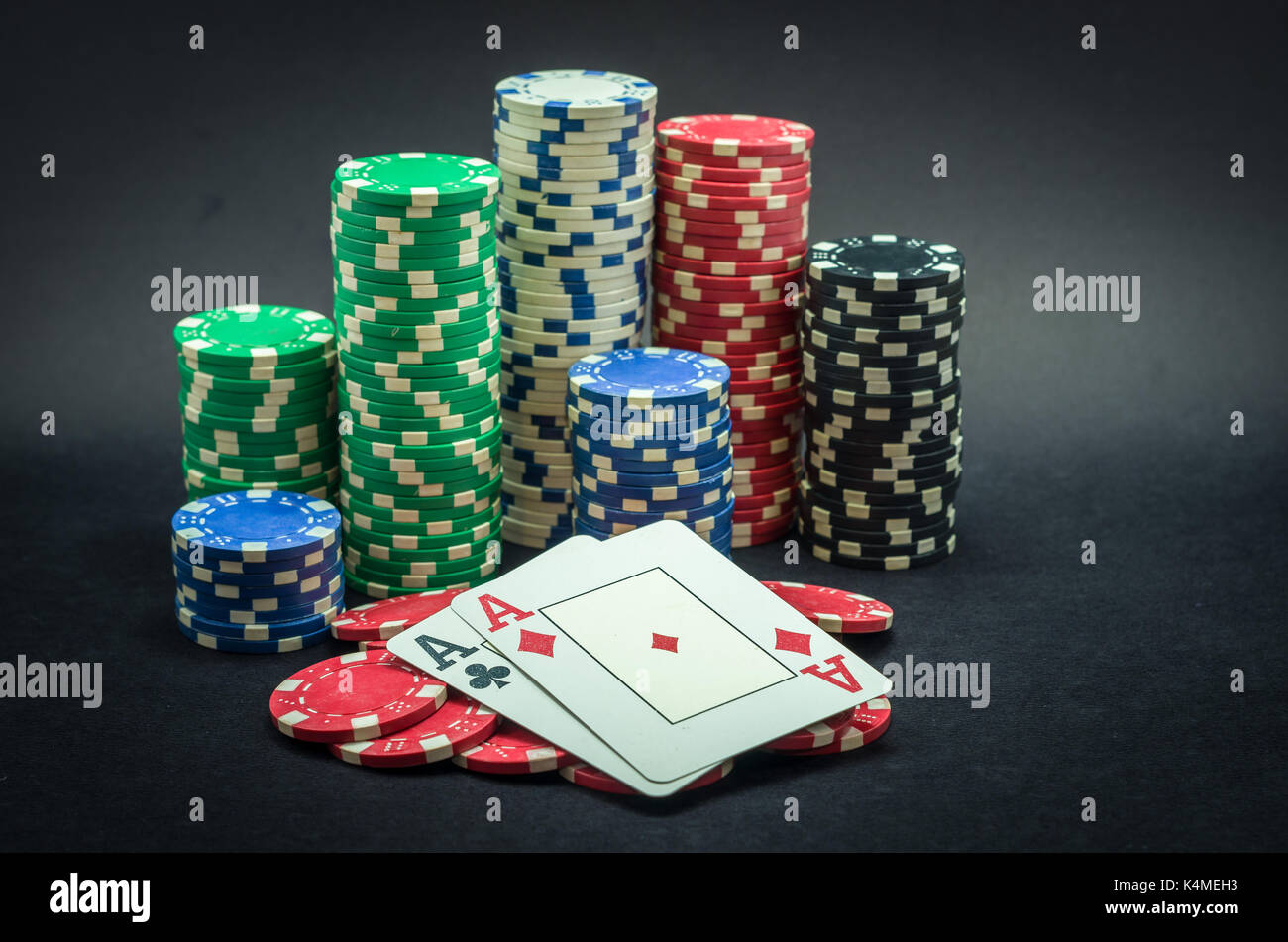 Pair Of Ace Winner Poker Chips Stacked And Pair Of Aces Black Stock Photo Alamy