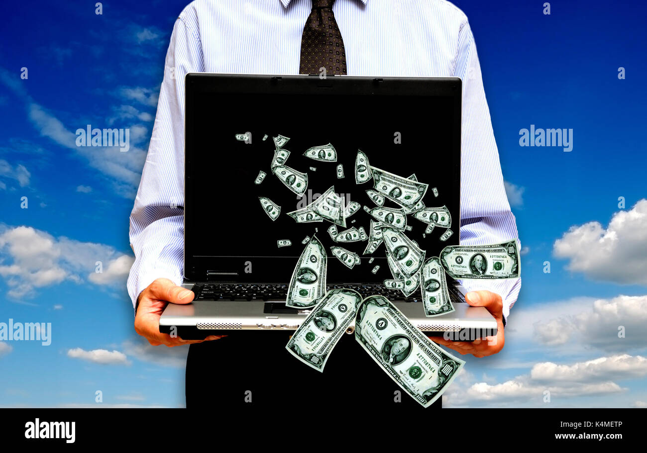 businessman with laptop and dollar banknotes coming out of it - Stock Image