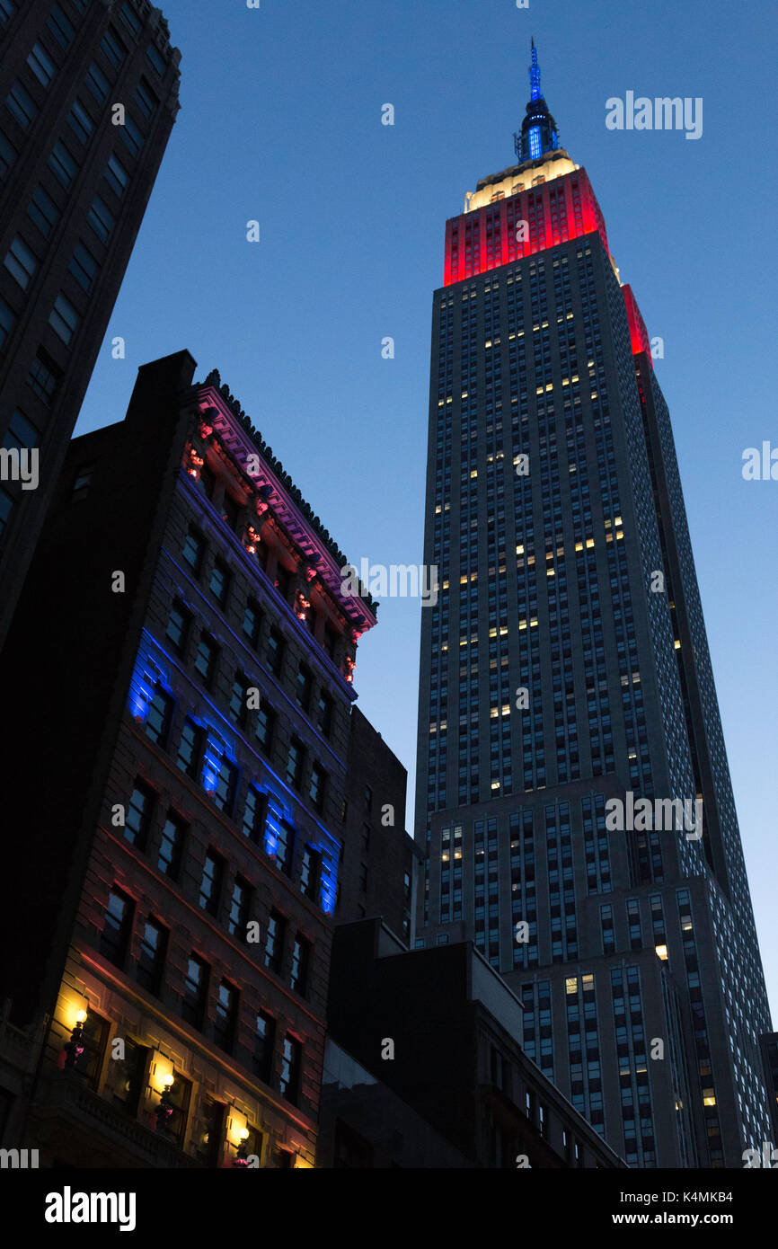 Empire State Building Looms over the Ditson Building at Dusk, NYC, USA - Stock Image