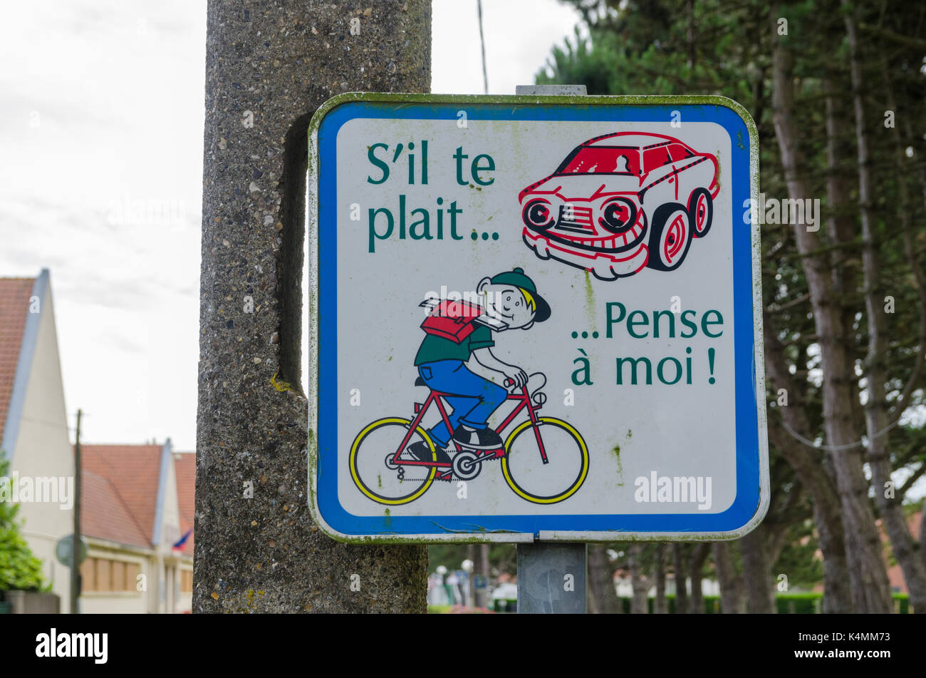 Sign asking motorists to take care with children on bicycles in Hardinghen, France - Stock Image